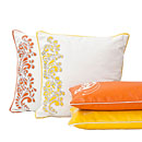 an arrangement of decorative pillows for corporate web-site and printed catalog