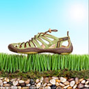 styled photograph of Jambu hiking shoe with grass and stones