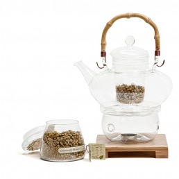 styled photography of glass tea set, with tea in a glass jar