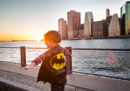 lifestyle shot of boy model with a view on Lower Manhattan