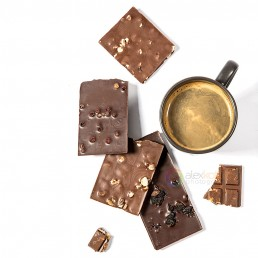 styled photography of different chocolate with nuts and a cup of coffee