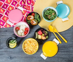 styled editorial photograph of bento set with food