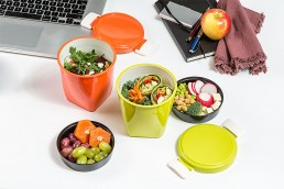 styled photograph of bento set with food and office accessories for advertising