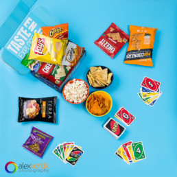 Styled image of snacks with table game UNO for Variety Fun brand